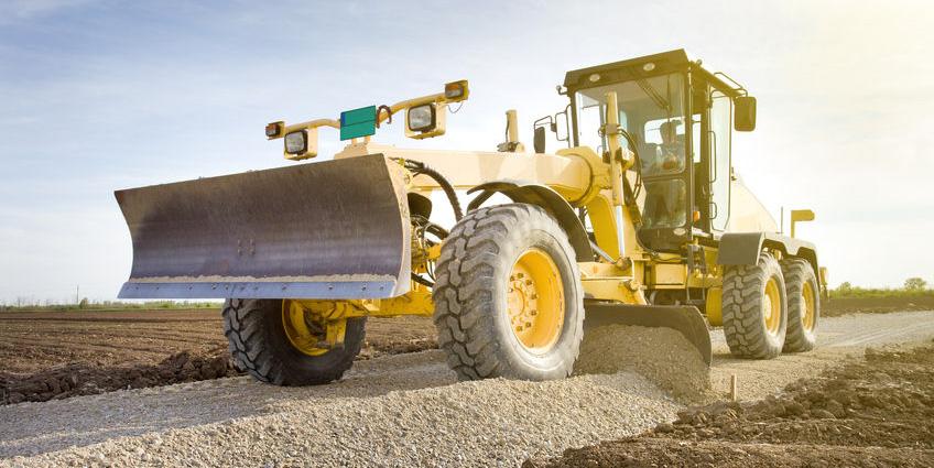 39315081 - grader leveling gravel on road construction site